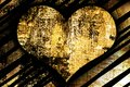 Textured golden metallic shining background and heart Royalty Free Stock Photo