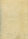 Textured grainy recycled paper with natural fiber parts Royalty Free Stock Photography