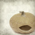 Textured old paper background with carved pumpkin Stock Image