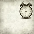Textured old paper background with fashioned alarm clock Stock Photo