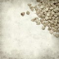 Textured old paper background with scattered buckwheat Royalty Free Stock Images
