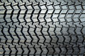 Textured tire tread photo coarse black large truck close up Royalty Free Stock Photography