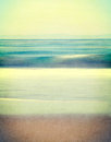 Textured vintage seascape an abstract ocean with blurred panning motion image displays a retro look with cross processed colors Stock Photography