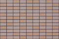Textured Wall Covered by Tiles of Light Orange, Beige and Flesh Colors Royalty Free Stock Photo