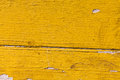 Textured wooden pattern. Aged wood planks background yellow paint Royalty Free Stock Photo
