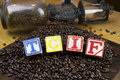 Tgif blocks set in coffee beans Royalty Free Stock Photos
