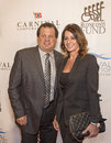 Th annual great sports legends dinner former hockey player michael eruzione and wife donna eruzione arrive on the red carpet for Stock Photography