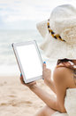 On th beach young woman using tablet against background Royalty Free Stock Images