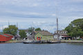 Th century sailing ships and riverside wharfs along the thames river of old mystic seaport connecticut Stock Photos