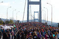 Th istanbul eurasia marathon people are crossing the bosphorus bridge from asia to europe during fun run on november in Stock Photography