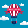4th of july American independence day greeting card with hot air balloon in american flag colors with red ribbon. Royalty Free Stock Photo