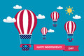 4th of july American independence day greeting card with hot air balloons in american flag colors with red ribbon. Royalty Free Stock Photo