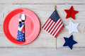 Th of july picnic table with falg a ready for a a red plate fork and spoon american flag and felt stars decorate the Stock Images