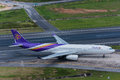 Thai airway airplane departure at phuket airport thailand october airways airbus vacated runway after landing in sunny day Stock Photos