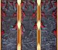 Thai art carving on temple door decorative by red Stock Photo