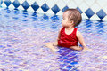 Thai baby girl be distracted in pool Royalty Free Stock Images
