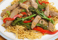 Thai beef broccoli stirfry with noodles and Stock Photo