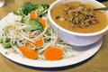 Thai Beef Curry Noodles with Raw Vegetables Stock Photography