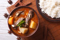 Thai beef massaman curry and rice side dish closeup. horizontal Royalty Free Stock Photo