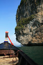Thai boat front and cliffs Royalty Free Stock Photo