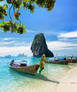Thai boats on phra nang beach thailand Stock Photos