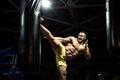 Thai boxer punch kick by punching bag