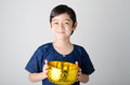 Thai boy hand holding bowl for water festival Royalty Free Stock Photo