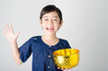 Thai boy splashing water by using hand  from bowl Royalty Free Stock Photo