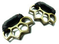 Thai brass knuckle-duster on white. Royalty Free Stock Photos