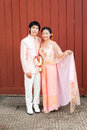 Thai bridal in thai wedding suit with flowered garland asian Royalty Free Stock Images