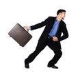 Thai businessman pulling disobedient bag Stock Images