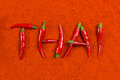 Thai chili hot red peppers on powder background Stock Photo