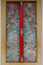 Thai and chinese art paint mural on multi colors door in temple at chonburi thailand Stock Image