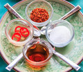 Thai condiment set which has vinegar sugar chilli and fish sauce it is called in kruang prung Stock Image