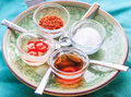 Thai condiment set which has vinegar sugar chilli and fish sauce it is called in kruang prung Royalty Free Stock Image