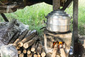 Thai cooking style, steam pot on vintage local fire-stove in kitchen of old wooden house Royalty Free Stock Photo