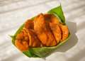 Thai dessert called krob kem or caramel crispy pastry in banana leaf bowl Royalty Free Stock Images
