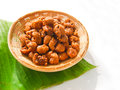 Thai dessert called krong krang krob or crispy pastry in bamboo bowl on banana leaf Stock Photos