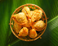 Thai dessert called pan klib or fried flour stuffed with fish on leaf Stock Photography