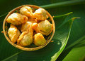 Thai dessert called pan klib or fried flour stuffed with fish on leaf Royalty Free Stock Image