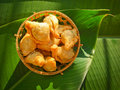 Thai dessert called pan klib or fried flour stuffed with fish on leaf Royalty Free Stock Photography