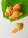 Thai dessert called pan klib or fried flour stuffed with fish on leaf Royalty Free Stock Photos