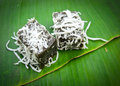 Thai dessert called pieak poon or black coconut sweet pudding sprinkle with on banana leaf Stock Images