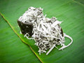 Thai dessert called pieak poon or black coconut sweet pudding sprinkle with on banana leaf Stock Photography