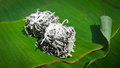 Thai dessert called pieak poon or black coconut sweet pudding sprinkle with on banana leaf Stock Photo