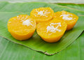 Thai dessert called pumpkin pudding made from sugar and coconut on banana leaf Royalty Free Stock Photos