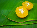 Thai dessert called pumpkin pudding made from sugar and coconut on banana leaf Stock Photography