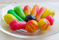 Thai dessert fruit-imitated soybean dumpling coated with jelly Royalty Free Stock Photo