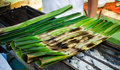 Thai dessert jak made from coconut covered with banana leaves Stock Image