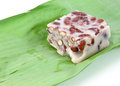 Thai dessert made of taro and red beans wrapped in banana leaves Royalty Free Stock Photography